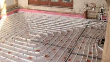 Exposed underfloor heating, before the floor is finished.