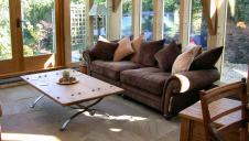 Lounge furniture in a new oak framed garden room.