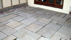 A newly laid stone floor, ready for pointing.