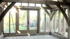 An empty oak framed extension.
