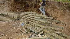A timber lattice being constructed for use as a retaining wall.