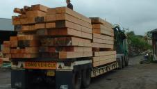 Planed and oiled Douglas fir frame arriving on a lorry.