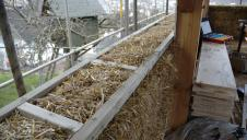 A straw bale wall being built.