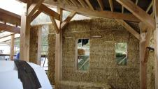 An almost finished straw bale wall.