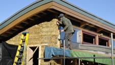 The outside of a straw bale house, during its construction.