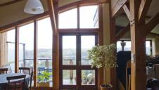 A feature window within the living space of a timber framed straw bale house.