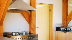 Douglas fir beams in a modern timber framed kitchen.