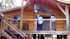 Cabin style eco-house built on greenheart stilts.