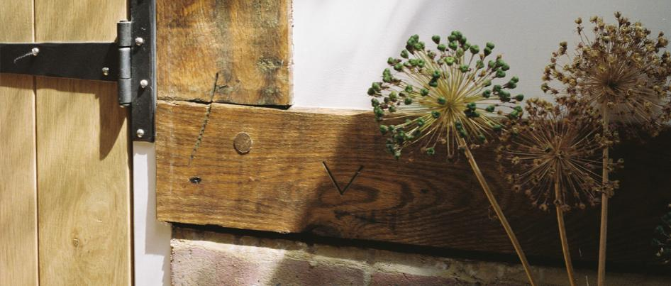 Uncleaned oak beam showing carpenter's mark.