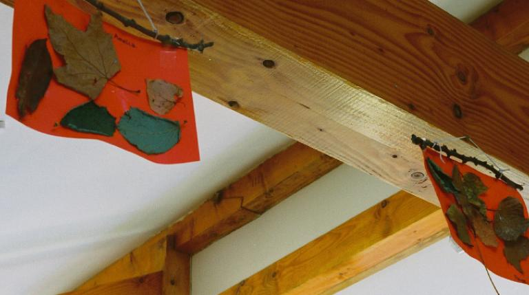 Children's collages on a Douglas fir beam.