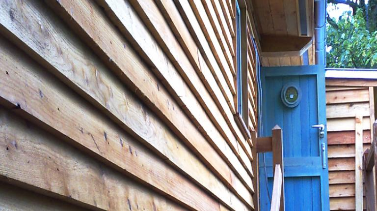 Timber cladding on a cabin style eco house.