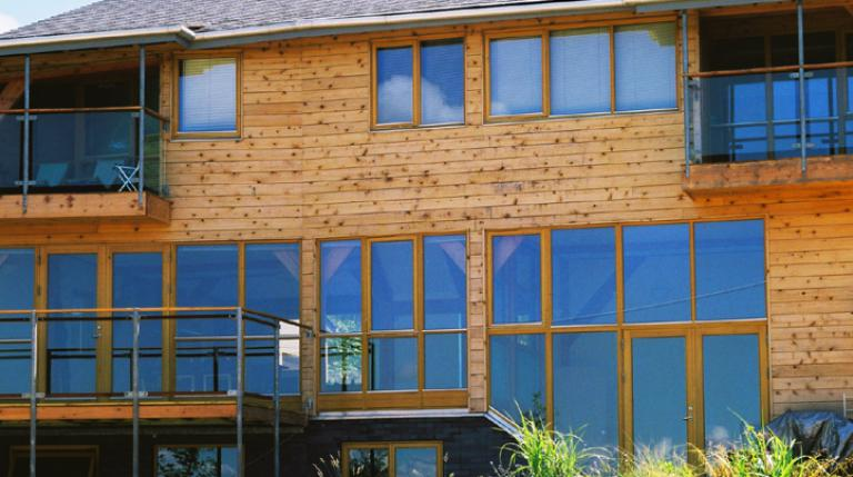 Douglas fir framed house with timber cladding and direct glazing.