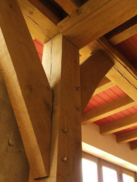 Exposed oak floor beams, posts and joints.