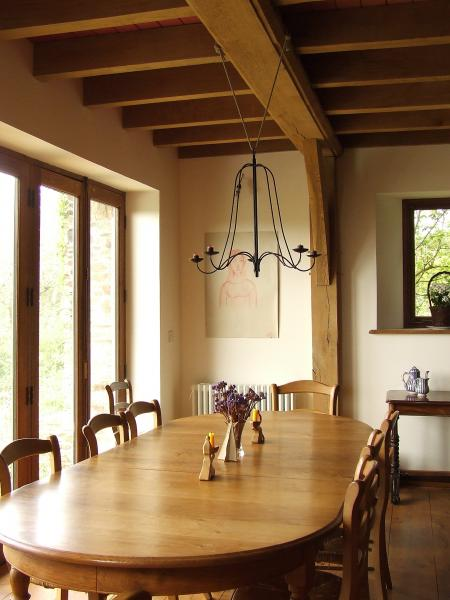 Oak framed dining room with hanging candelabra and french doors.