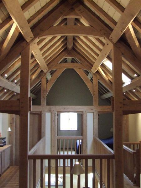 A gallaried stairwell with exposed oak roof.