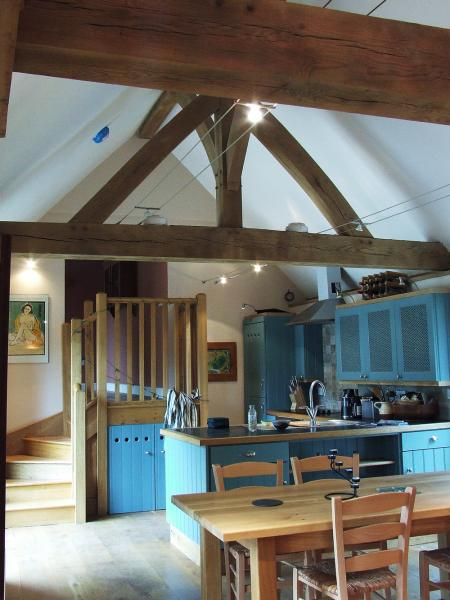 Oak trusses in the kitchen of a barn conversion.