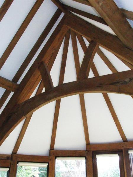 Central arch brace truss in a curved extension.