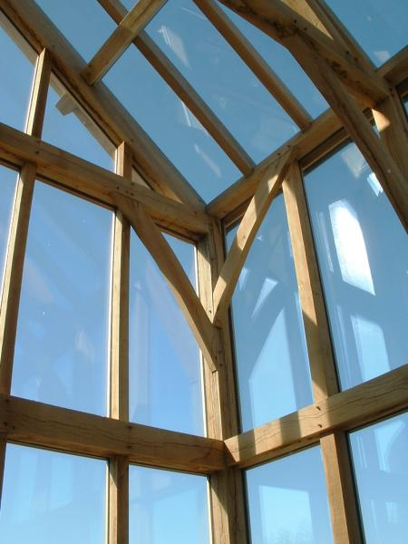 An oak skeleton frame with direct glazed walls and roof.
