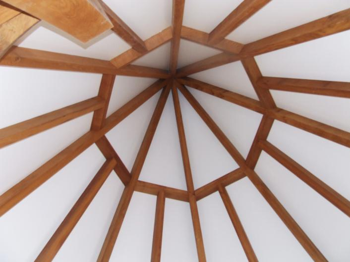Inside the apex of a timber frame spire.