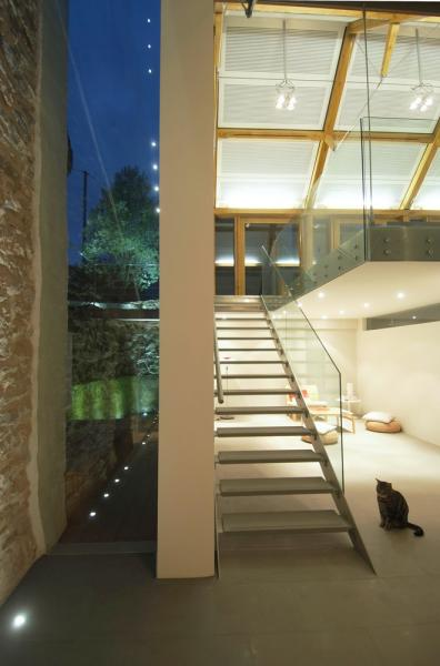 Glass and steel staircase in a modern barn conversion.