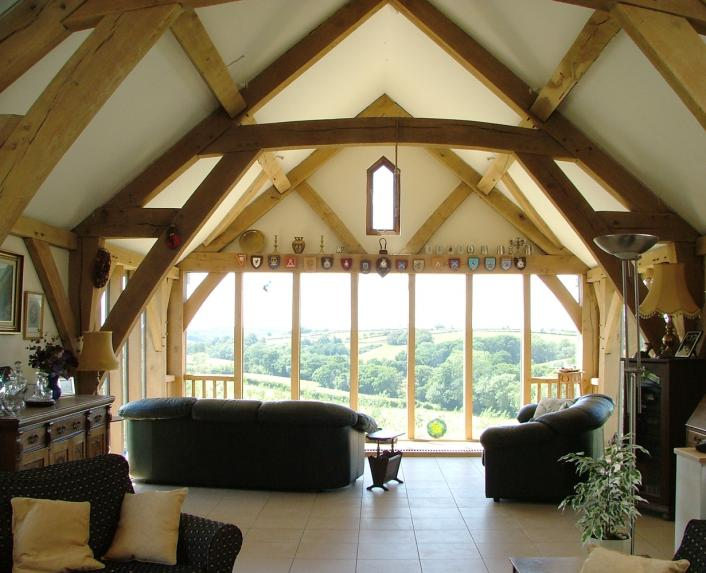 The view from the living room of an upside down, oak framed house.