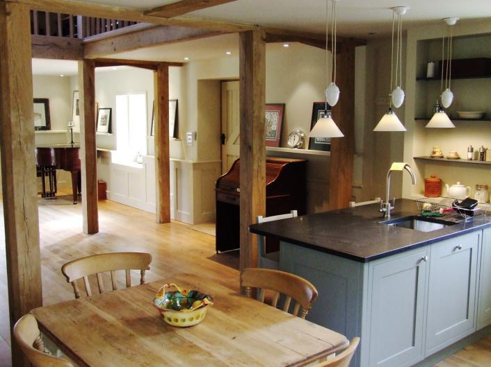 The kitchen area of an open plan oak barn conversion.