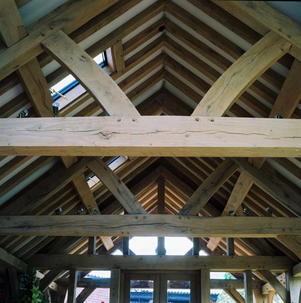 Simple oak frame barn roof in a garden room style extension.